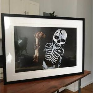 Framed photograph of kid dressed up for Mateo Gras